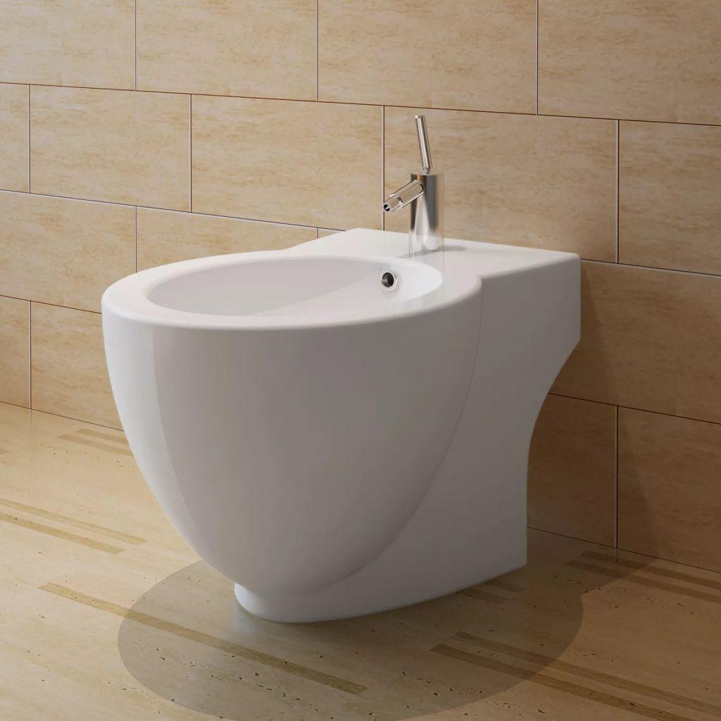 Keramisk toalett och bidé vit